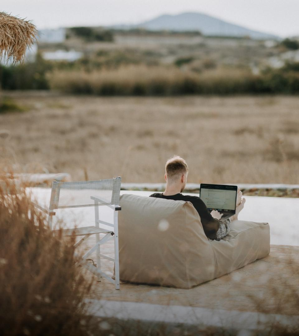 Man on Laptop Outside